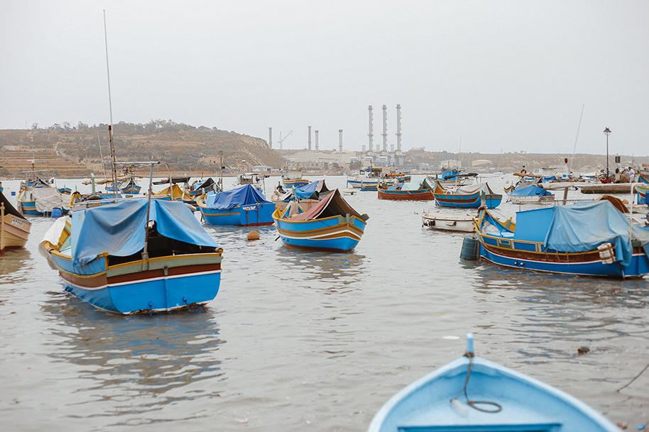 Luzzu boats in a Marsaxlokk bay, Malta