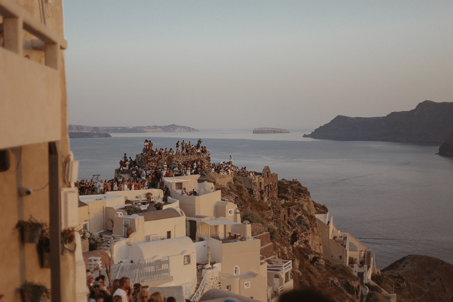 Crowds of people in Oia city during the sunset time