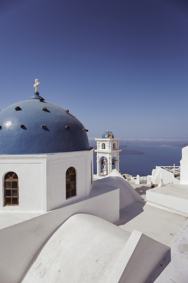 Typical Santorini colors - the white church with a blue dome